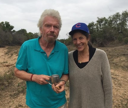 Debra on safari with Richard Branson and family (she loves her Chicago Cubs)